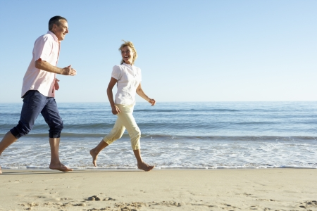 casual clothing: Senior Couple Enjoying Romantic Beach Holiday