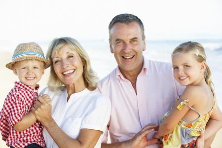 Grandparents And Grandchildren Enjoying Beach Holiday photo