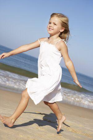 5 year old girl: Little Girl Running Along Beach