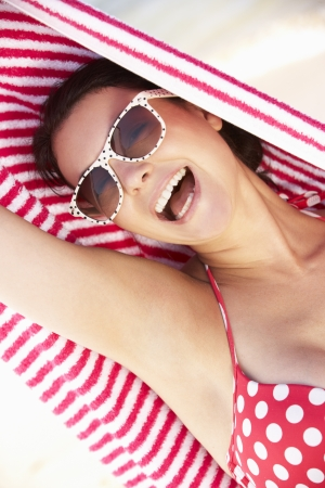 Woman Sheltering From Sun On Beach Holiday photo