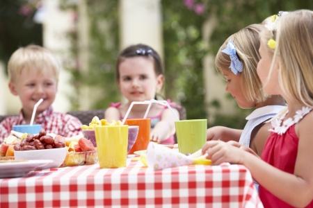 Group Of Children Enjoying Outdoor Tea Party Stock Photo - 18719945