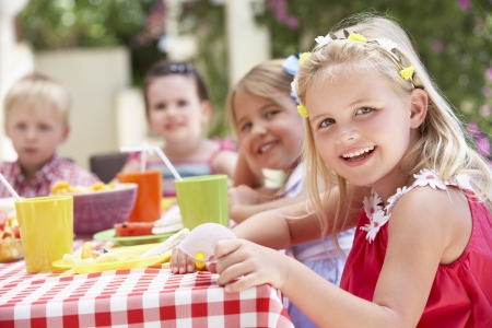 Group Of Children Enjoying Outdoor Tea Party Stock Photo - 18721782