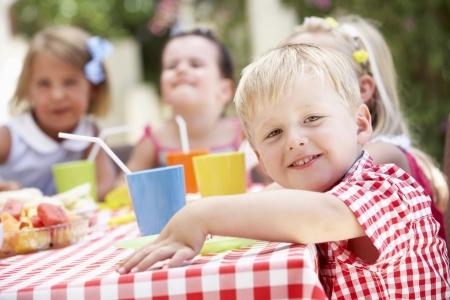 Group Of Children Enjoying Outdoor Tea Party Stock Photo - 18720812