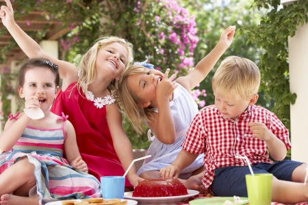 Group Of Children Eating Jelly At Outdoor Tea Party Stock Photo - 18722938