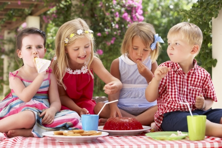 Group Of Children Eating Jelly At Outdoor Tea Party Stock Photo - 18723071