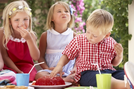 Group Of Children Eating Jelly At Outdoor Tea Party Stock Photo - 18723005