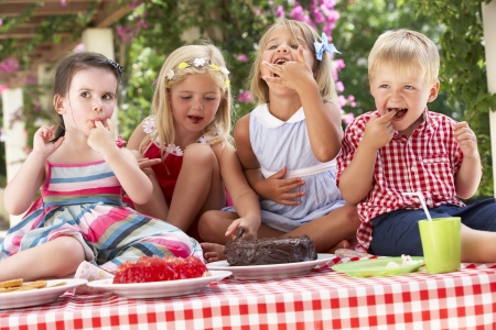 Group Of Children Eating Jelly And Cake At Outdoor Tea Party Stock Photo - 18723080