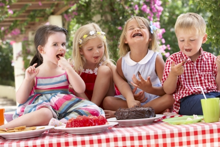 jello: Group Of Children Eating Jelly And Cake At Outdoor Tea Party