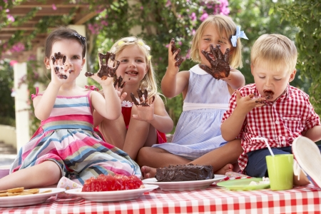 Group Of Children Eating Jelly And Cake At Outdoor Tea Party Stock Photo - 18723174