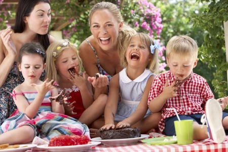 birthday food: Children And Mothers Eating Jelly And Cake At Outdoor Tea Party