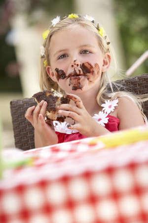 Messy Girl Eating Chocolate Cake photo