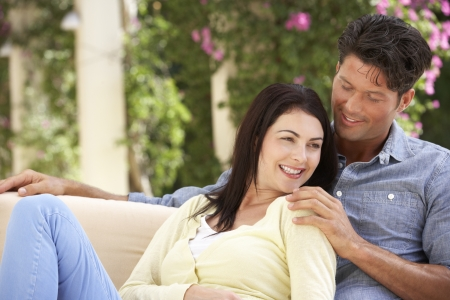 couple having fun: Couple Relaxing On Sofa At Home