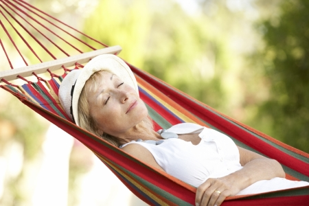 rest in peace: Senior Woman Relaxing In Hammock Stock Photo