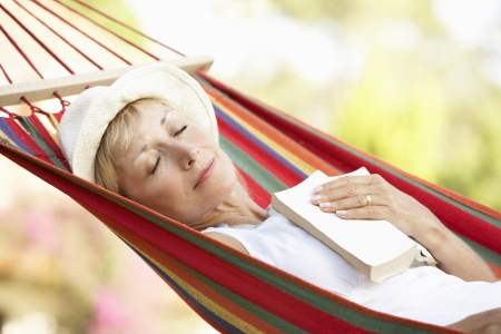 resting: Senior Woman Relaxing In Hammock Stock Photo