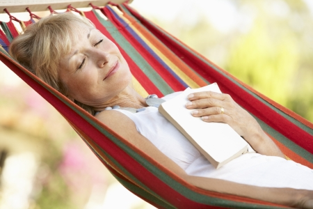 woman relaxing: Senior Woman Relaxing In Hammock Stock Photo
