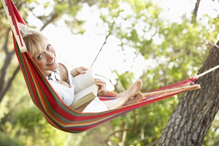 rest in peace: Senior Woman Relaxing In Hammock Stock Photo
