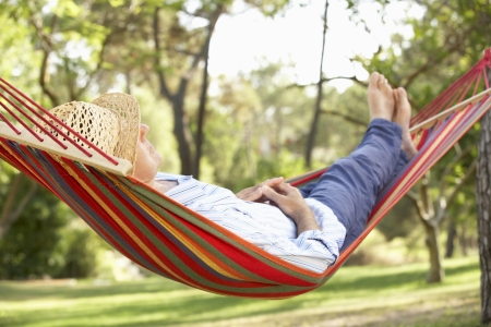 hammock: Senior Man Relaxing In Hammock