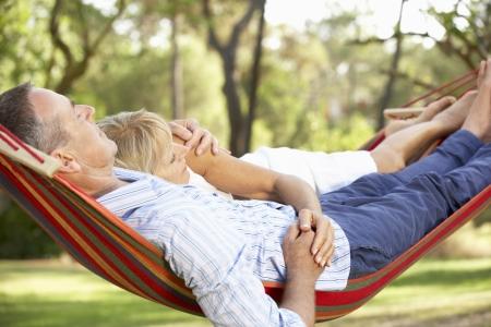 hammocks: Senior Couple relax in amaca Archivio Fotografico