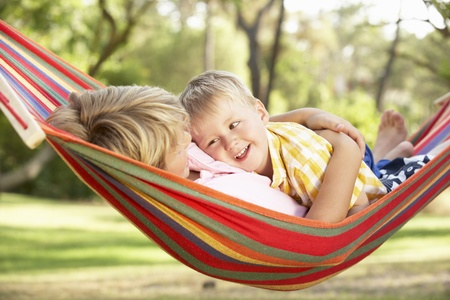 Two Boys Relaxing In Hammock photo