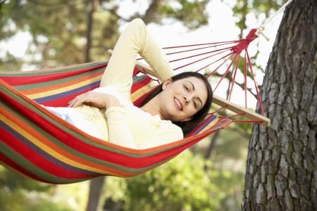 Woman Relaxing In Hammock Stock Photo - 18721919