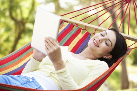 Woman Relaxing In Hammock With  E-Book photo