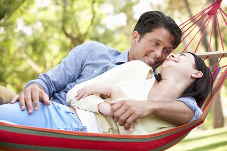Couple Relaxing In Hammock Stock Photo - 18722020
