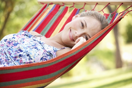 Woman Relaxing In Hammock photo