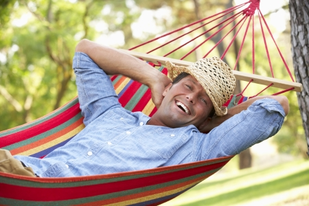 rest: Man Relaxing In Hammock