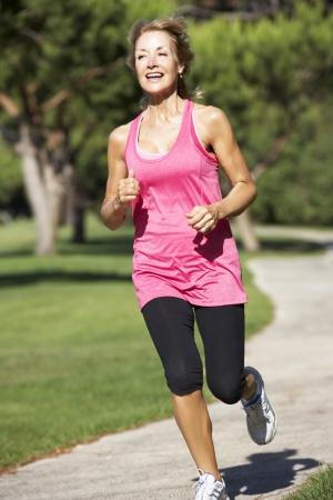 Senior Woman Exercising In Park Stock Photo - 18719870