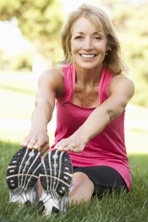 keeping fit: Senior Woman Exercising In Park
