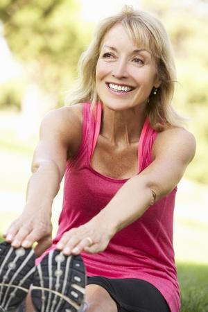 excercise: Senior Woman Exercising In Park