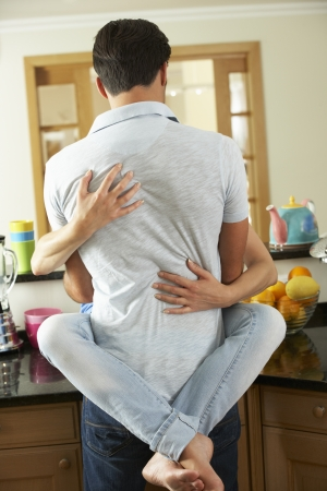 Romantic Couple Hugging In Kitchen photo