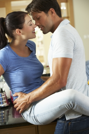 passionate: Romantic Couple Hugging In Kitchen Stock Photo
