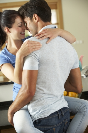 Romantic Couple Hugging In Kitchen Stock Photo - 18722770
