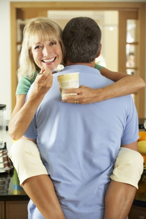 Romantic Senior Couple Hugging And Eating Ice Cream photo