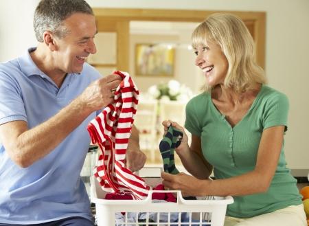 man laundry: Senior Couple Sorting Laundry Together
