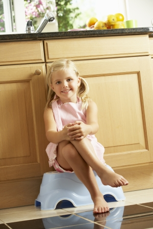 5 year old girl: Girl Sitting On Plastic Step In Kitchen