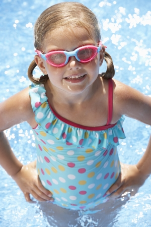 5 year old girl: Portrait Of Girl In Swimming Pool Stock Photo
