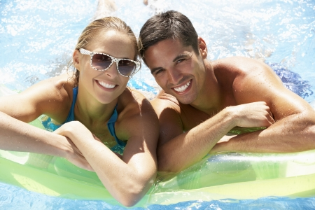 Couple Having Fun In Swimming Pool photo