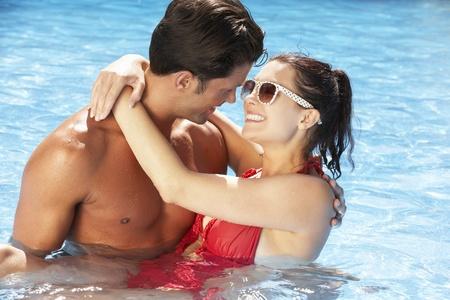 Couple Having Fun In Swimming Pool photo