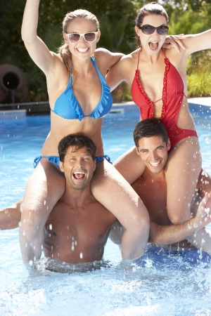 Group Of Friends Having Fun In Swimming Pool photo