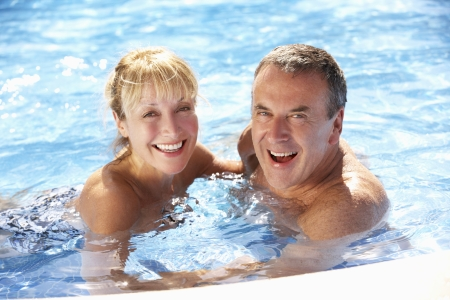 excercise: Senior Couple Having Fun In Swimming Pool