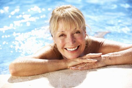 Senior Woman Having Fun In Swimming Pool photo