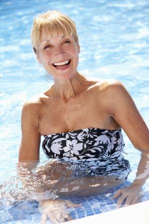 vertical wellness: Senior Woman Having Fun In Swimming Pool