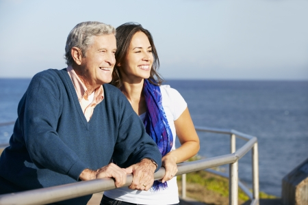 Senior Man With Adult Daughter Looking Over Railing At Sea Stock Photo - 18732492