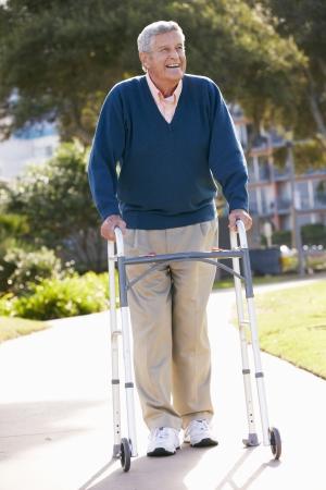one senior adult man: Senior Man With Walking Frame