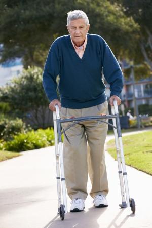unhappy man: Senior Man With Walking Frame