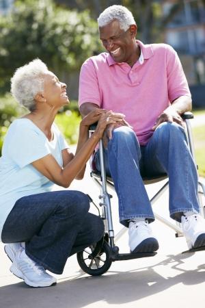 black nurse: Senior Woman Pushing Husband In Wheelchair
