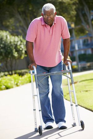 the ageing process: Senior Man With Walking Frame