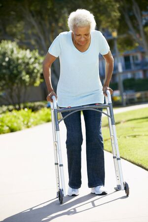 Senior Woman With Walking Frame photo